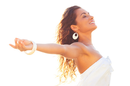 arms outstretched: Smiling Relaxed Young Woman Extending Her Arms And Closing Her Eyes In Summer