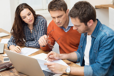 business planning: Businessmen and businesswoman working with document in office