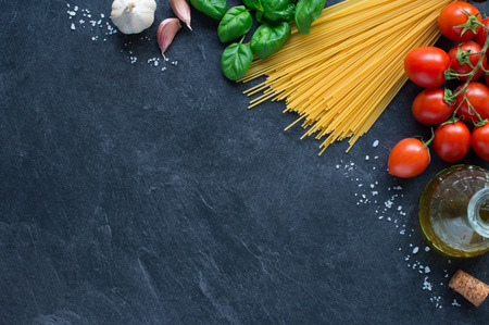 blackboard: Spaghetti, tomatoes and others ingrdients for italian pasta on blackboard