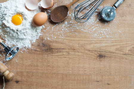fresh bakery: Fresh ingredients and cooking utensils on rustic table