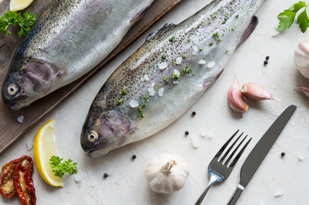 freshwater fish: Fresh raw trouts on cutting board Stock Photo