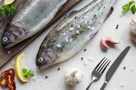 Fresh raw trouts on cutting board Stock Photo