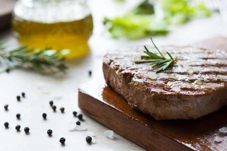 steak beef: Grilled fillet steak on wooden cutting board