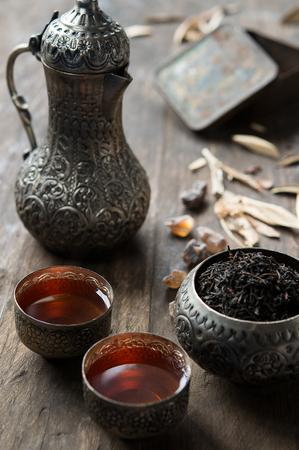 tea service: Ethnic tea serve on typical arabic tea service on rustic table Stock Photo