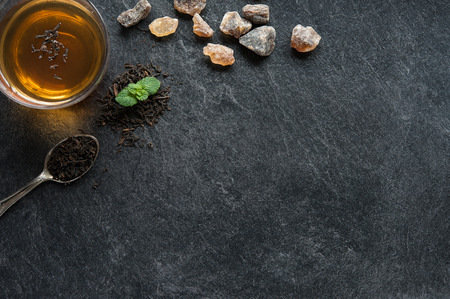 plant antioxidants: A cup of tea on blackboard with sugar crystals Stock Photo