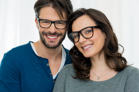 happy young couple: Closeup of smiling couple wearing spectacle Stock Photo