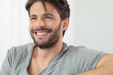 Closeup of smiling man looking away