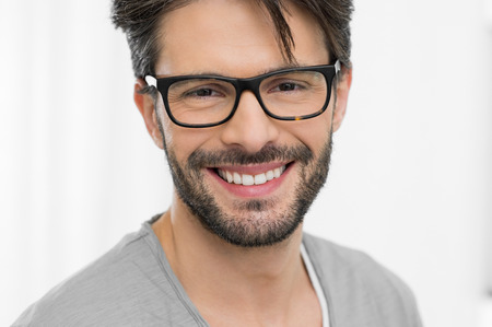 Closeup of smiling man wearing spectacle