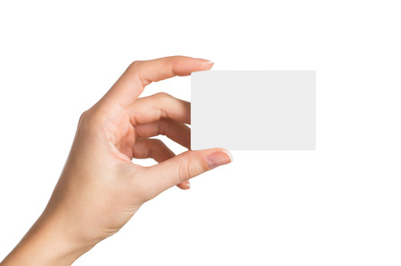 Closeup shot of a woman hand holding blank business card isolated on white background. Close up hand showing visit card. 版權商用圖片