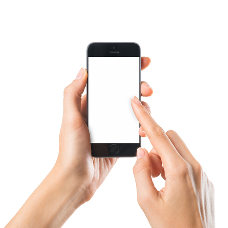 Closeup shot of a woman typing on mobile phone isolated on white background.. Girls hand holding a modern smartphone and pointing with figer. Blank screen to put it on your own webpage or message.
