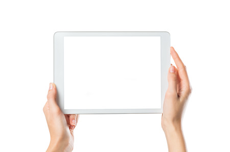 Closeup shot of woman hands holding digital tablet isolated on white background. Female hands holding a palmtop with white screen. Digital tablet with white display ready for your webpage or design.