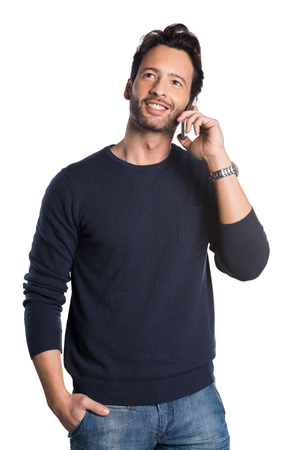isolated man: Young handsome man talking over phone and looking away isolated on white background.