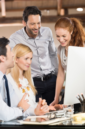 gaining: Group of happy business people after gaining success in strategy. Stock Photo