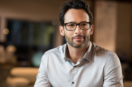 Portrait of a young handsome businessman wearing glasses.