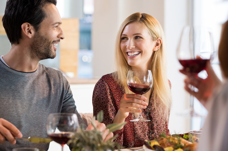Young couples enjoying wine and drinks.