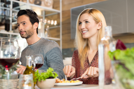 Portrait of happy young couple eating food.
