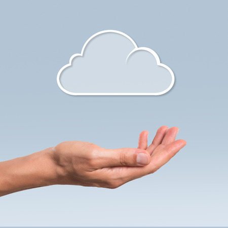 Female hand hold a cloud symbolyzing the cloud computing. Internet and cloud computing technology.