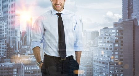 Double exposure image of a modern confident businessman over a city view. Business man with skyscrapers in background during the morning sunlight. Business on the move concept. photo