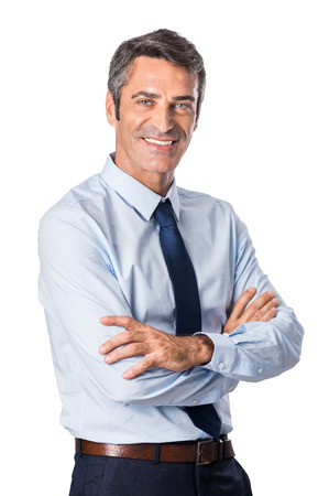 Mature businessman looking at camera with arms crossed and satisfaction. Portrait of happy senior businessman isolated on white background. Handsome man in formal smiling. Фото со стока