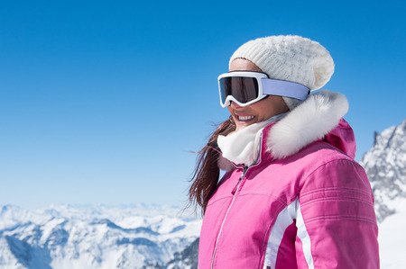 cold: Young woman wearing ski glasses outdoor in winter. Stock Photo