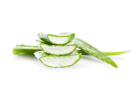 Closeup of aloe vera fresh leaves isolated on white background. Aloe sliced with aloe vera leaf on white backgroud. Medicine health, skin care and beauty concept.