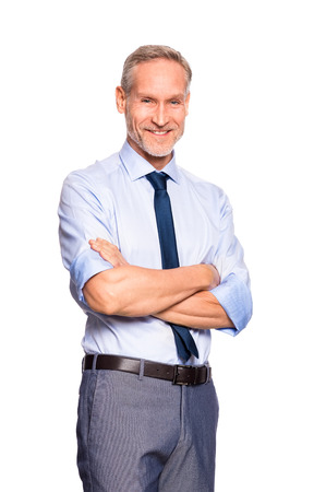 Portrait of successful mature businessman looking at camera isolated on white background. Cheerful senior business man standing with crossed arms. Smiling manager in formal isolated over white background.