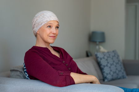 Portrait of mature woman recovering after chemotherapy. Stock Photo