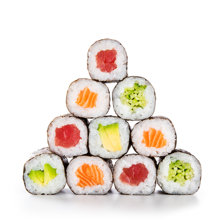 Fresh hosomaki in a pyramid isolated on white background. Sushi roll with salmon, tuna, avocado and cucumber. Traditional japanese food with maki. Delicious sushi pieces.