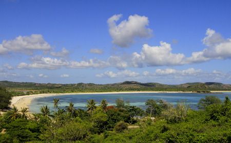 panorama of white sandy beach with blue sky