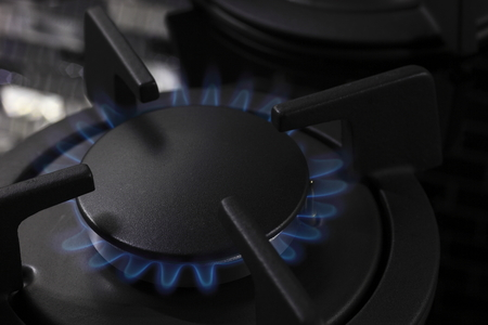 wastage: macro photographed in artificial light natural gas stove