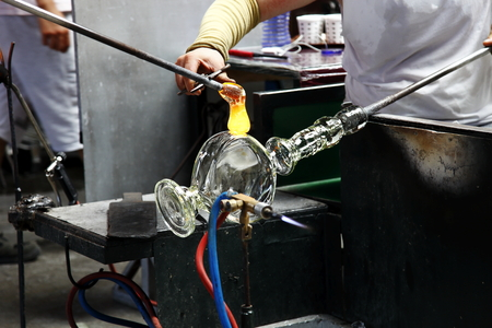 forming: Production of glass, hot glass forming, industrial image Stock Photo