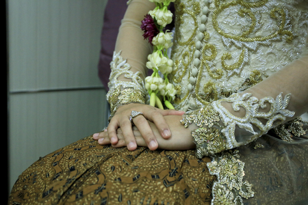 Traditional Javanese Woman Hands. Using Kebaya and Batik. Ready for Traditional Wedding Ceremony 스톡 콘텐츠