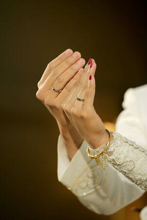 Javanese Bride and Groom Hands showing wedding rings 写真素材
