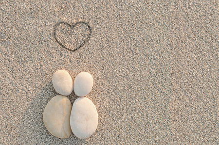 Pebbles shapes lovers with heart on the sand Stok Fotoğraf - 34814378