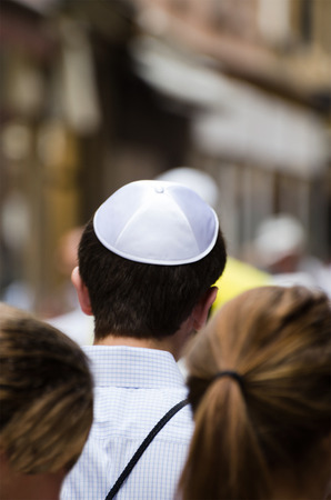 hasidic: Jewish man in a crowd on the street of Jerusalem Stock Photo