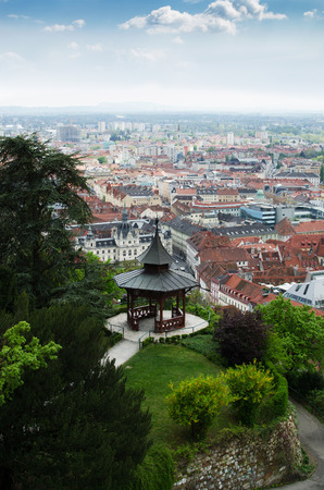 Park with pavilion on a top of hill with a view of Graz, Austria