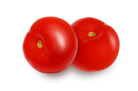 Two fresh red tomatoes isolated on a white background photo