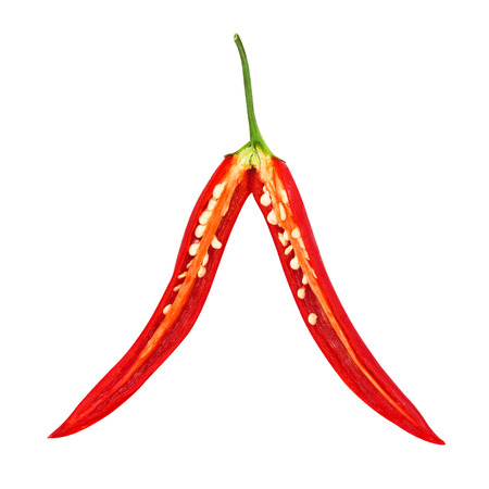 Fresh cut in half chilli pepper isolated on a white background photo