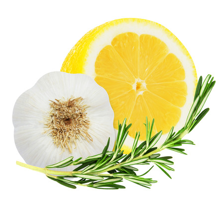 Juicy yellow lemon with a sprig of rosemary and garlic head isolated on a white background photo
