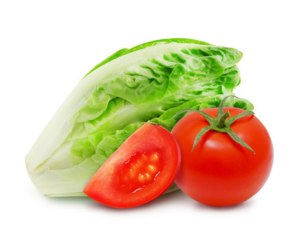 Isolated fresh salad romaine lettuce and red tomato with slice of ripe tomato on a white background. Design element for product label, catalog print, web use. Stock Photo