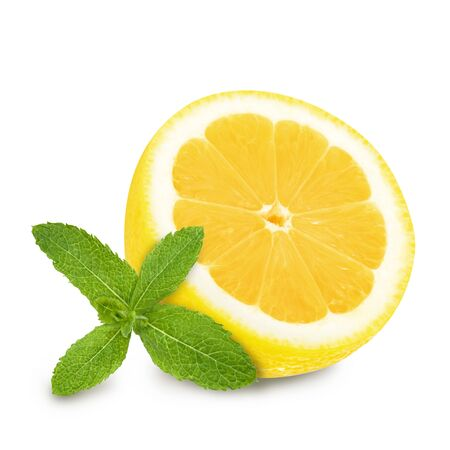 Juicy yellow lemon half sections with sprig of green mint isolated on a white background. Design element for product label, catalog print, web use.