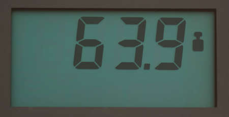 Scale, showing 63.9 kg on LCD display