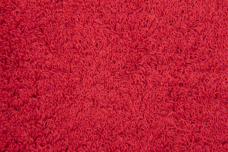 zommed into a red terry cloth towel