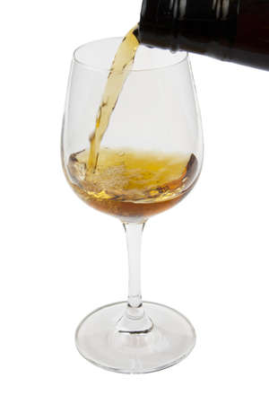 Pouring old wine into a glass, isolated on white background