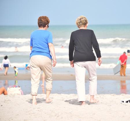 khakis: Two Senior Ladies Walking on Beach