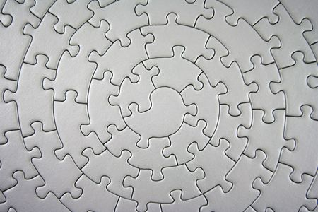 complete grey jigsaw wide angle - pieces fitting together in form of a spiral Stock Photo