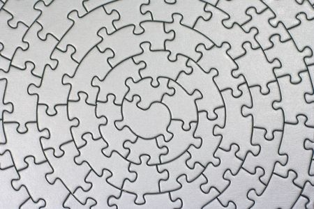 jig: complete silver jigsaw - pieces fitting together in form of a spiral -
