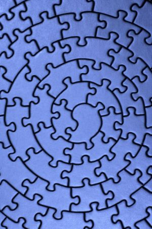 jig: complete jigsaw in blue - pieces fitting together in form of a spiral -
