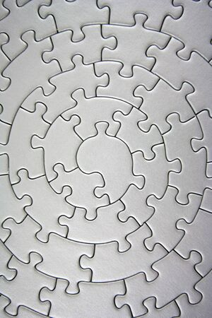 complete grey jigsaw wide angle- pieces fitting together in form of a spiral - Stock Photo - 1807828