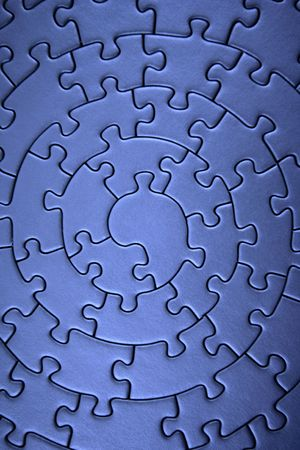 puzzle shape: complete blue jigsaw wide angle- pieces fitting together in form of a spiral -